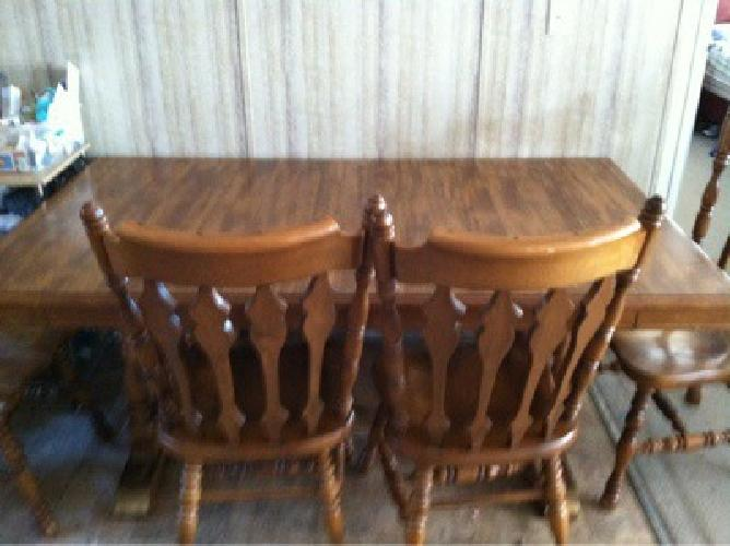 $100 Dinning room table and six chairs