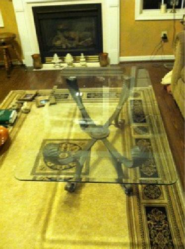 $100 Glass coffee table and matching end tables
