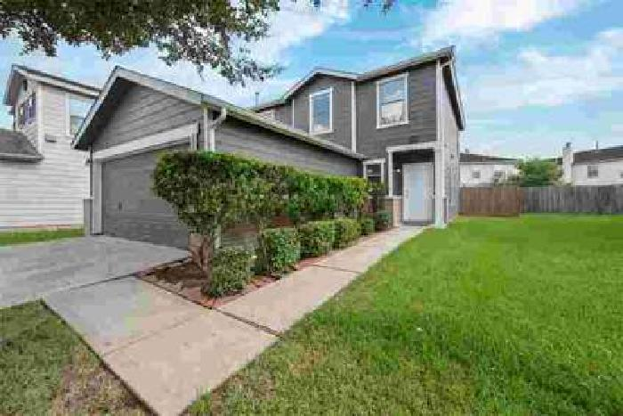 15514 Jasmine Tree Lane Houston Three BR, This home is located in