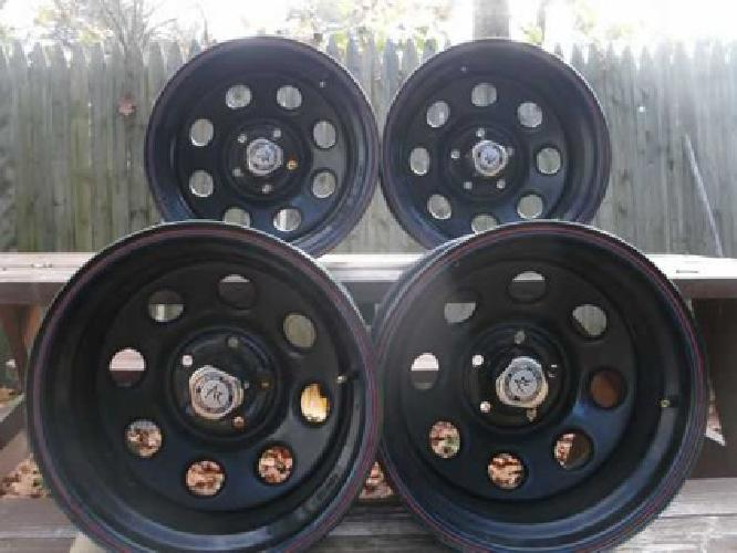 set of 4 american racing truck rims. 10 ins wide. 175 $ firm.*** phone ...