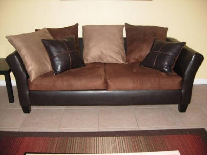 $180 Dark brown leather and suede sofa with oversize cushions for sale in Kissimmee Florida