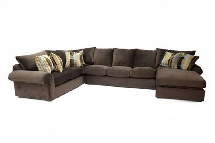 $1 453 U Shaped Sectional w ottoman 5 months old for sale