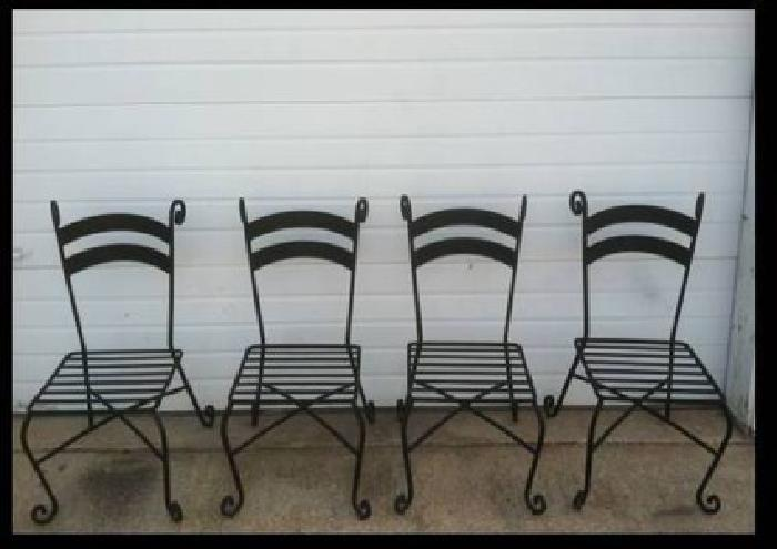 Four black heavy wrought iron patio dining chairs no cushions