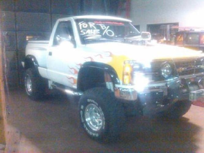 $25,000 1990 Restored and Lifted Chevy Truck Custom Paint Job. A must see
