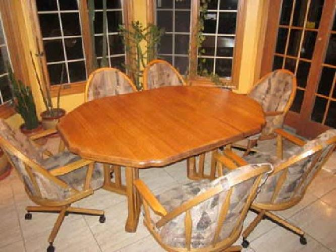 oak 6 person kitchen dinette set w 6 chairs on wheels for sale