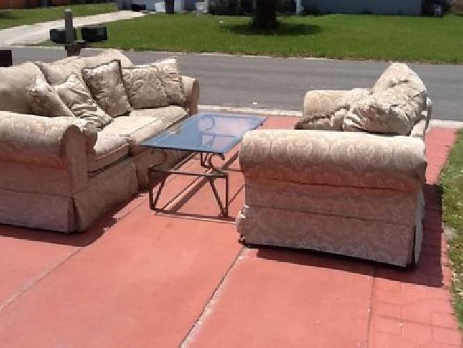 $300 Ashley Furniture sofa and loveseat with lots of