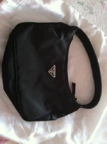 $30 100% Prada dress bag.