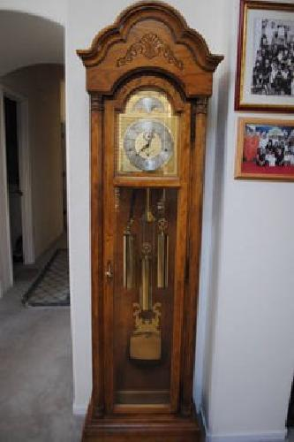 450 howard miller traditional oak grandfather clock moon dial arched - Howard Miller Grandfather Clock