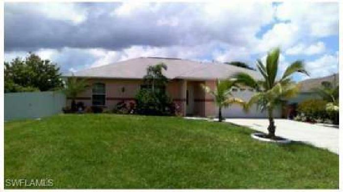 610 SE 3rd TER Cape Coral Three BR, This home features upgraded