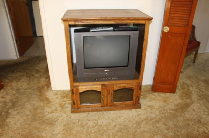 $70 T. V. with cabinet