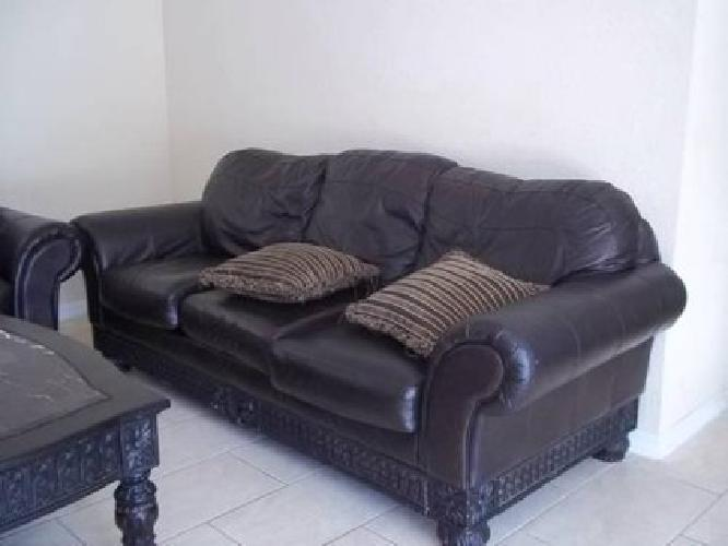 $750 Brown Leather Ashley Living Room Set
