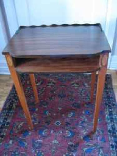 Cute ornate small end table. Solid Mahogany. $70.00 (Holladay)