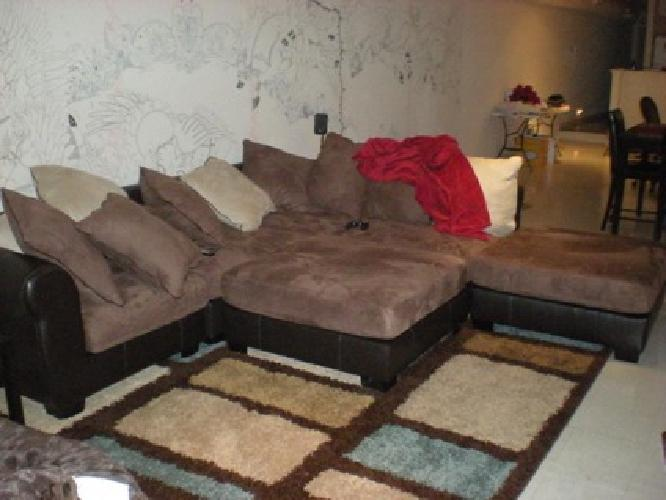 Large black and brown sectional sofa