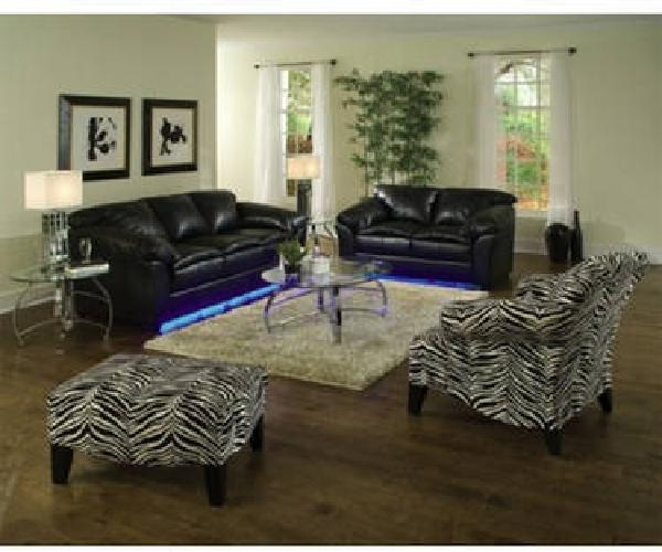 Living Room Black Leather Couches With Neon Lights And
